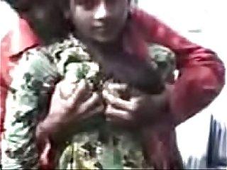 Indian boy rattle girlfriend pair in open-air