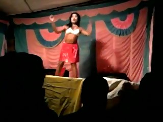 A seductive indian slut with nice boobs a firm ass and a horny choot dances and strips on stage while a border of horny guys watch her do it. Enjoy!